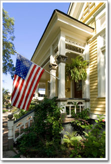House with flag on porch